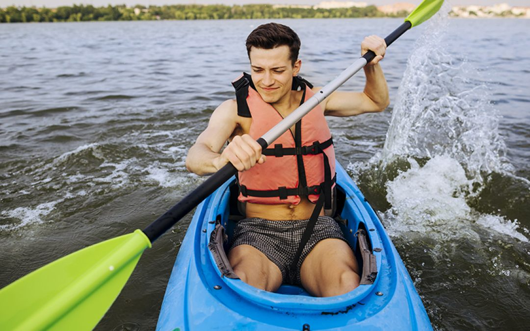man holding a paddle