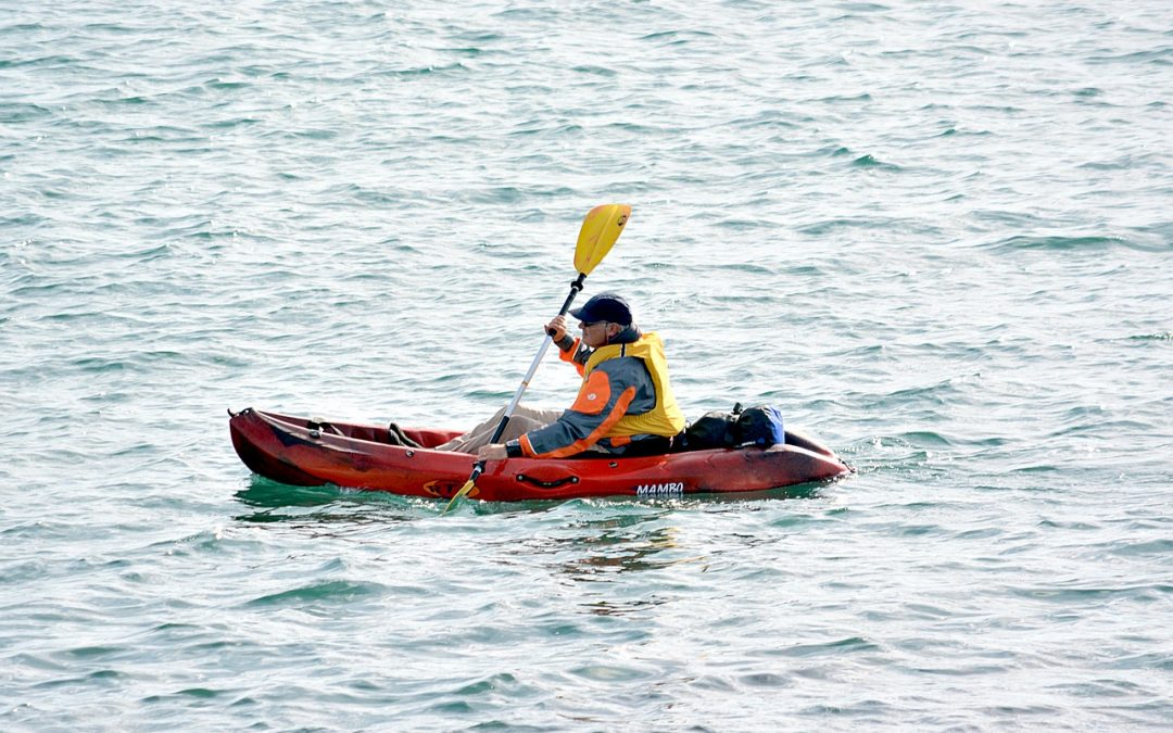 man on a kayak with paddle