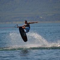 Man Wakeboarding and showing some trick over the water