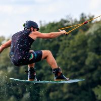 man on a wakeboard gripping to the best wakeboard rope