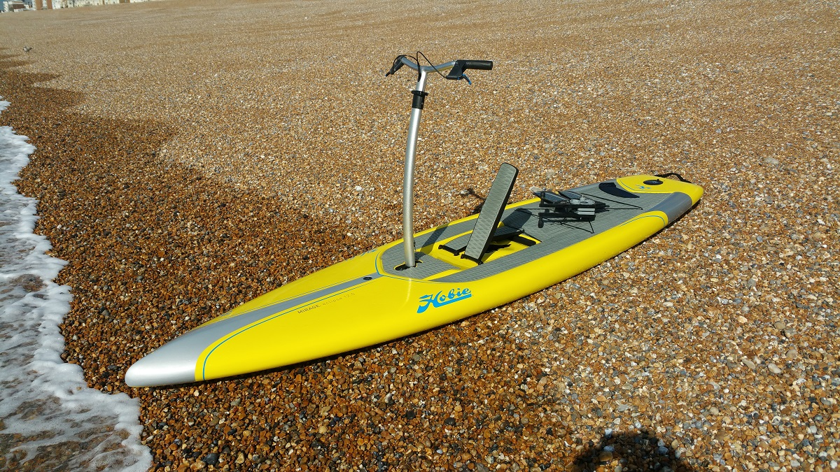 Yellow paddle board on seashore