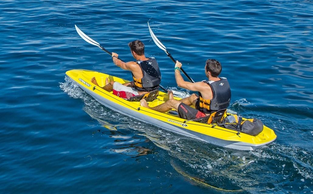 Two men riding yellow kayak