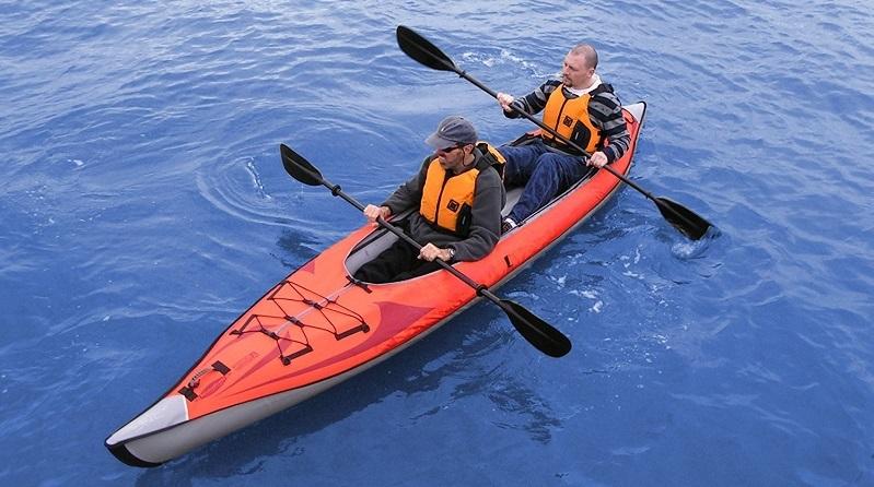 Two man riding Inflatable Kayak