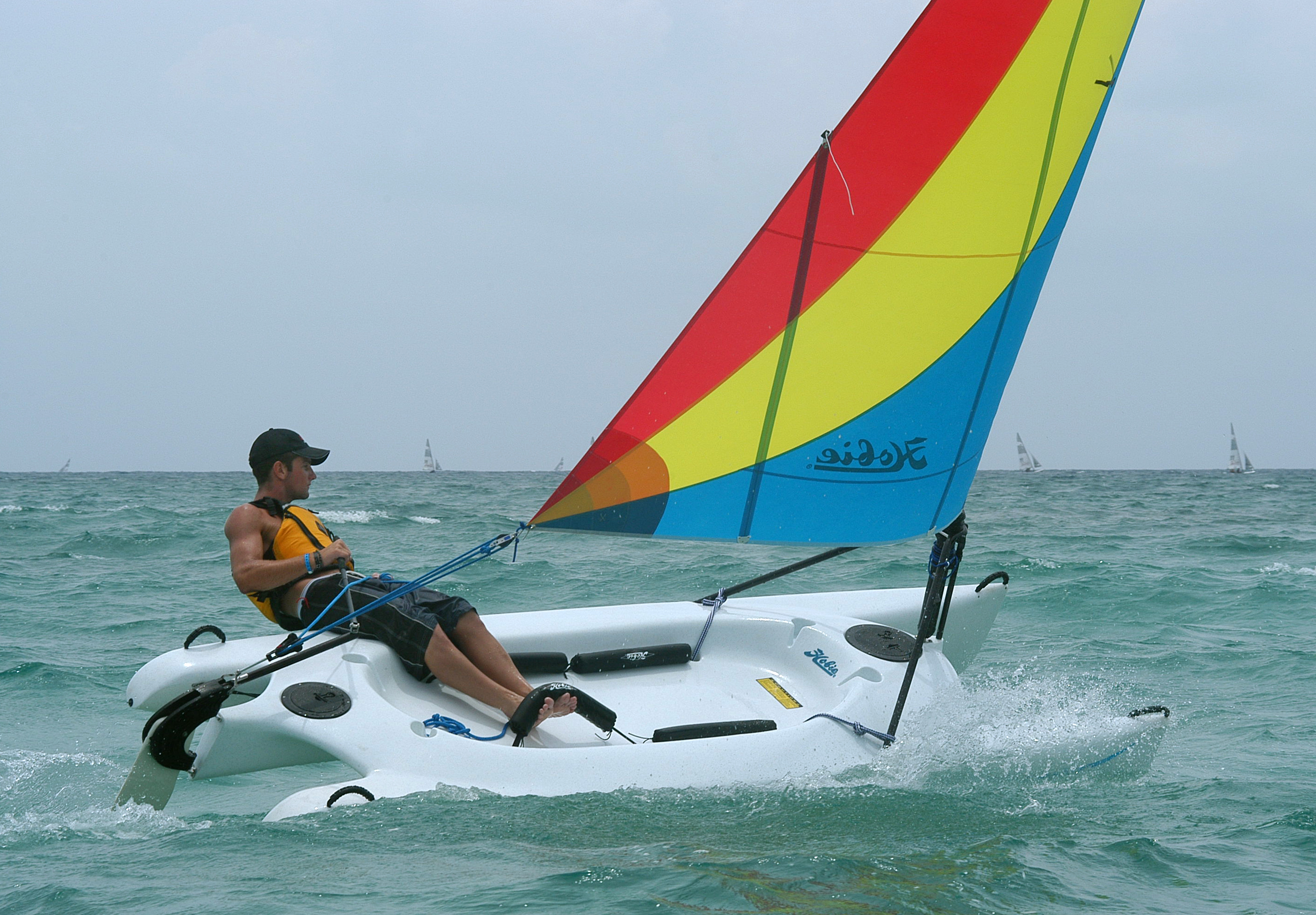 Man riding his hobie cat