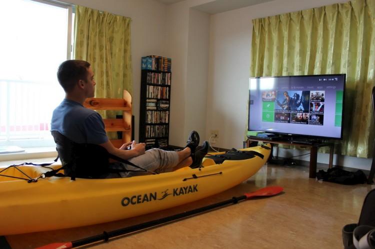 Man setting on yellow kayak