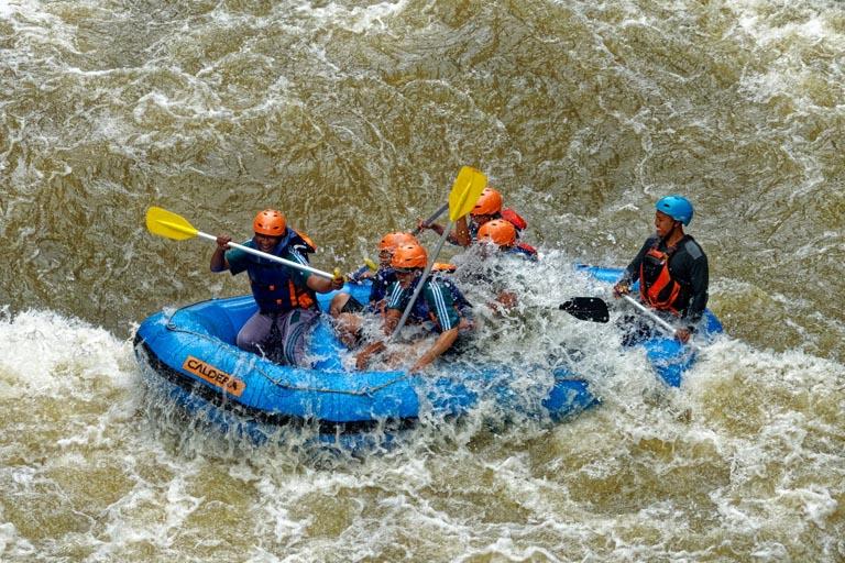group of people enjoying their whitewater rafting