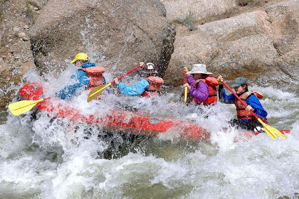 whitewater rafting in water rush beside big stones