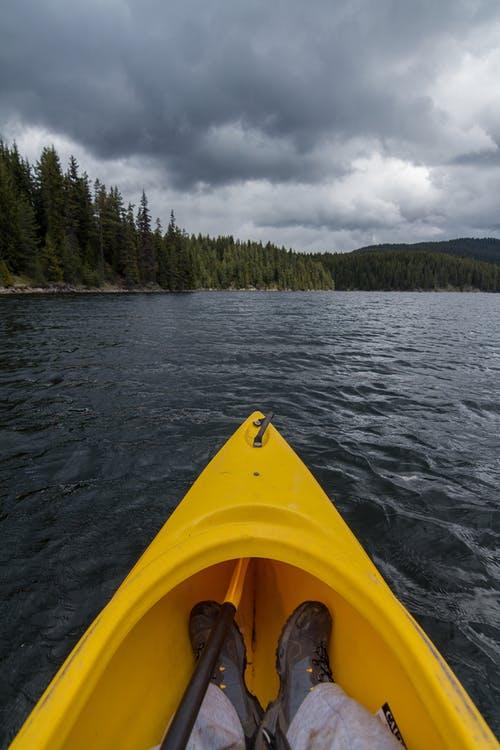 Man riding yellow kayak