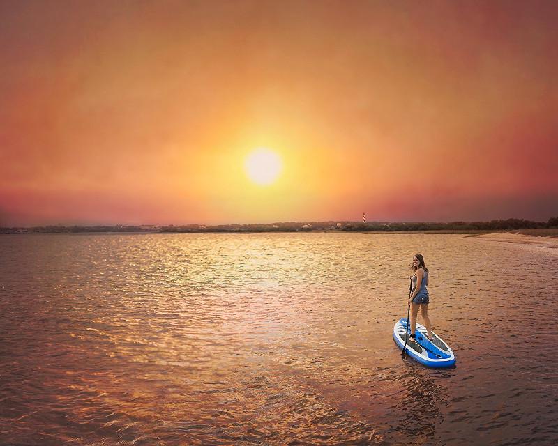 Woman under sunset