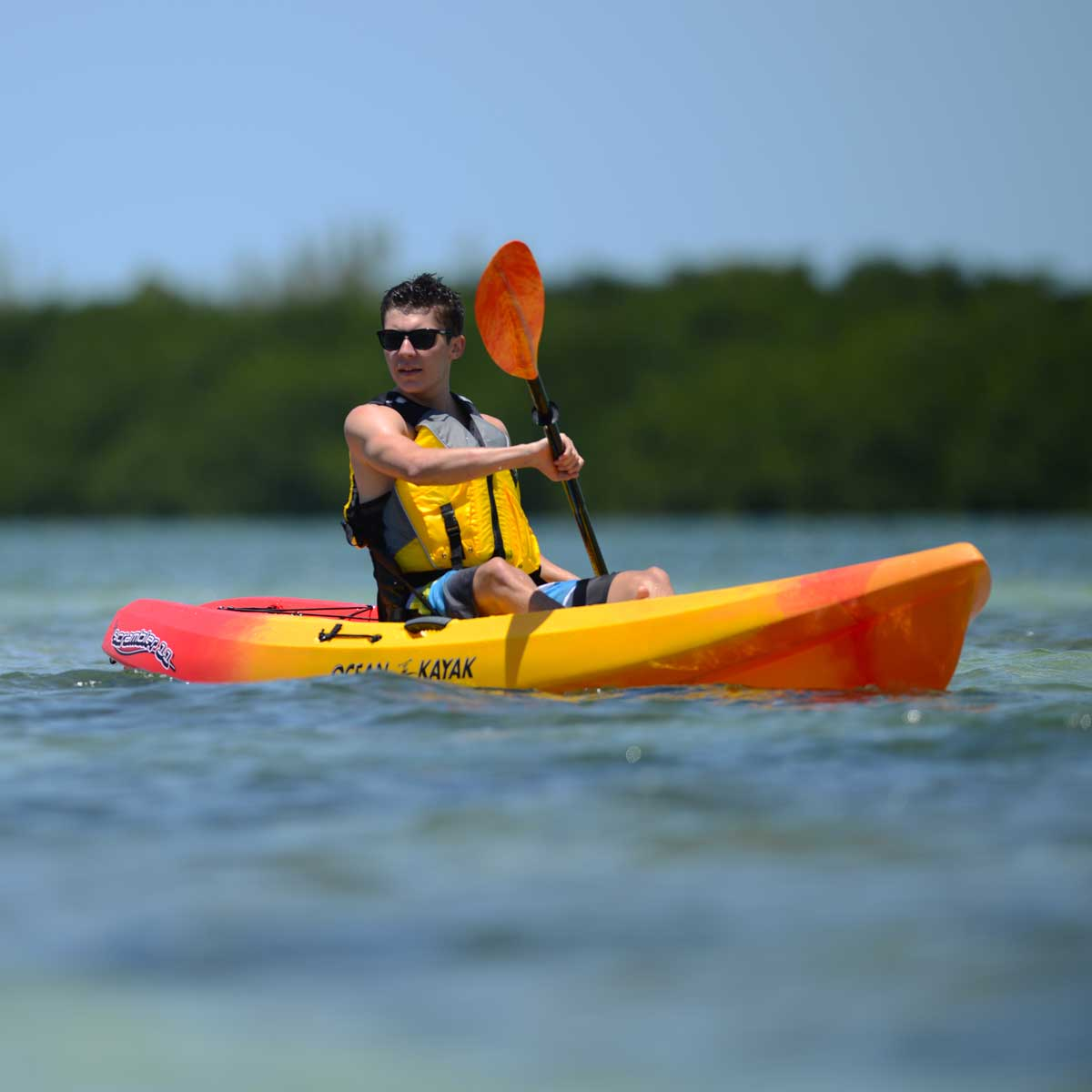 man on an ocean kayak scrambler