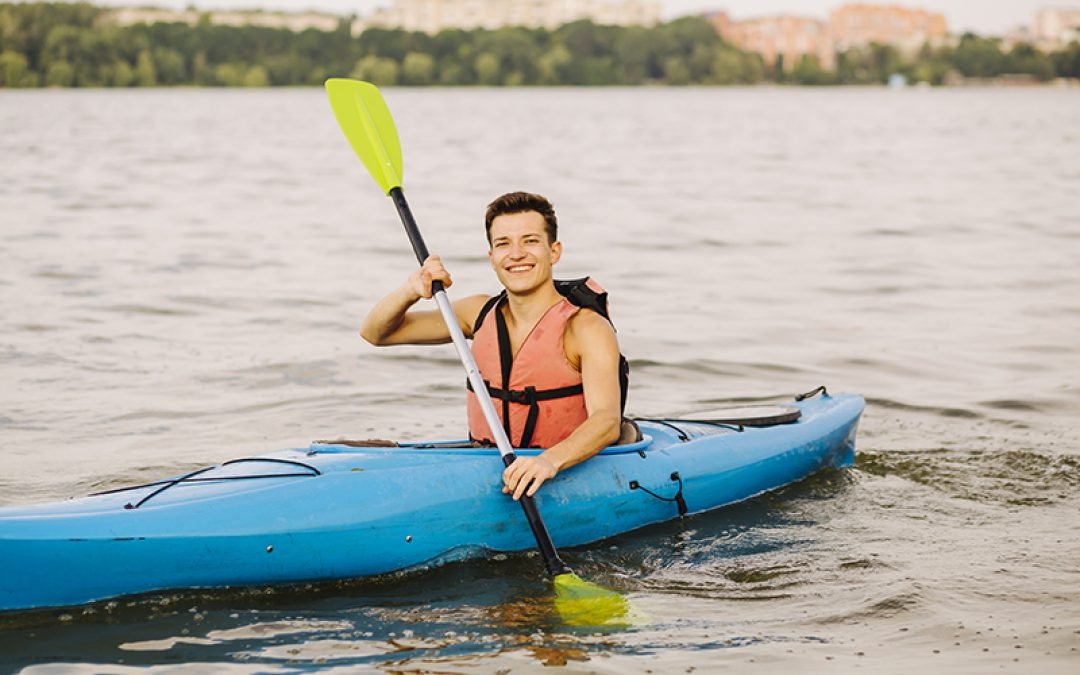 man smiling while in a mirage quest kayak