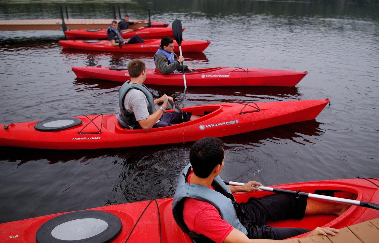 people riding kayaks