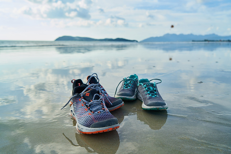 two water shoes at the beach