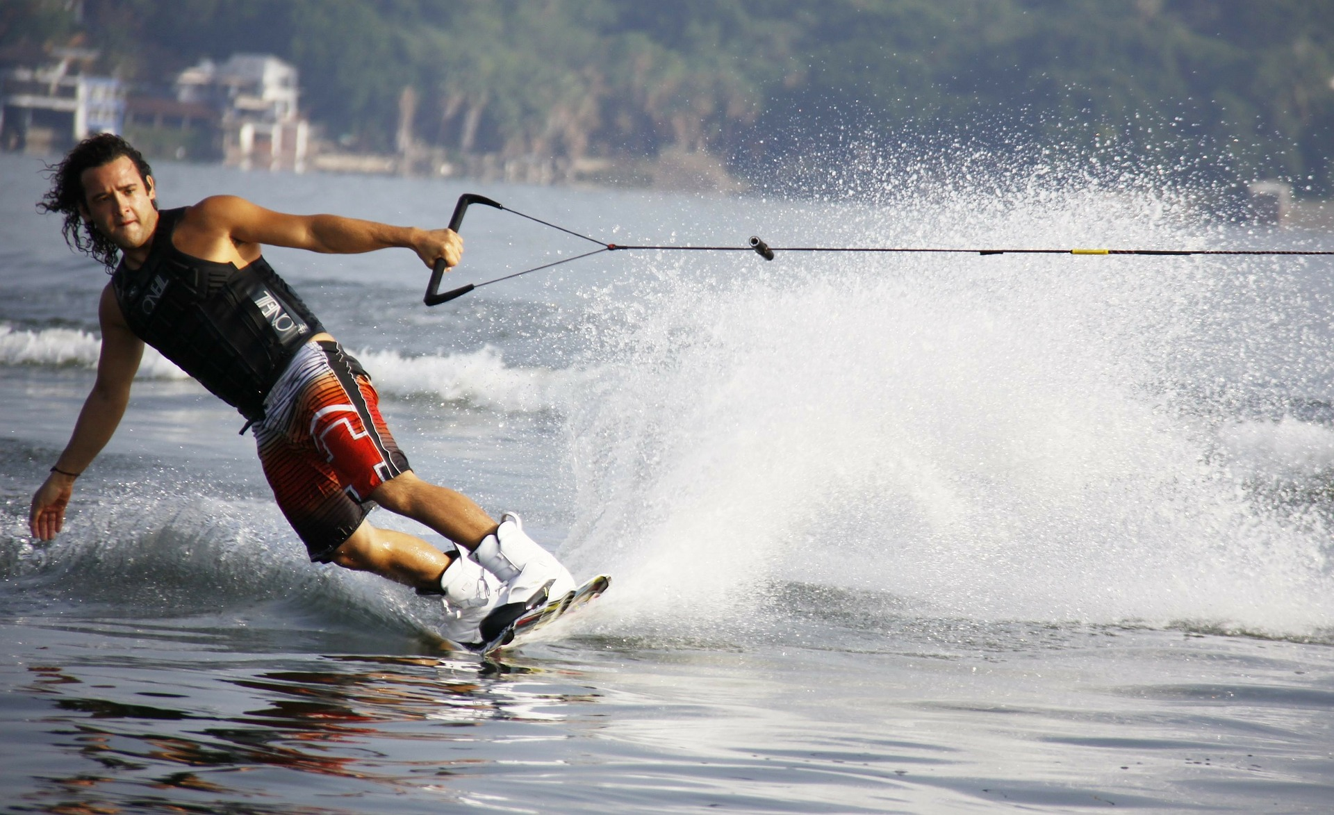 man wakeboarding over the waves of water
