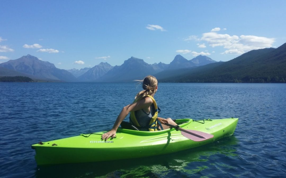 Woman sitting at the kayak boat