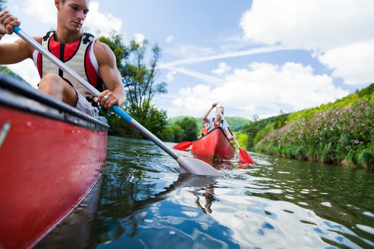 Man and woman are paddling the kayak boat