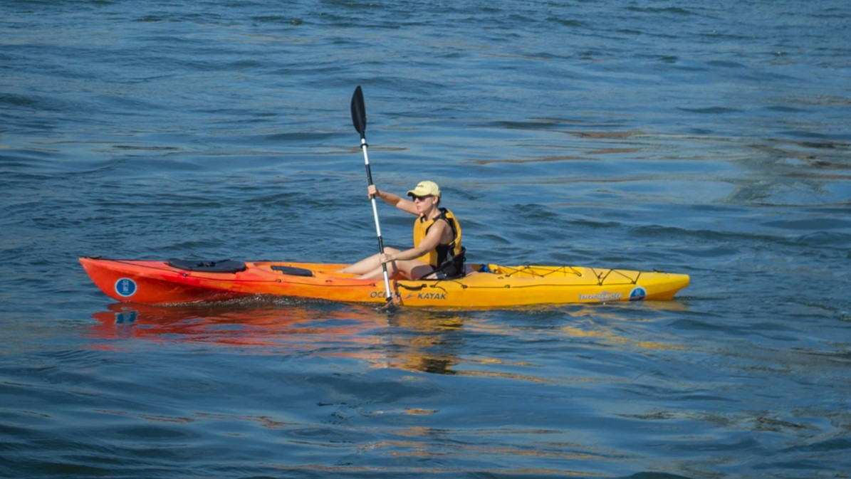 woman in a sit on top ocean kayak