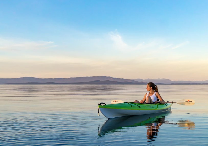 woman in a kayak enjoying the sun and the vitamin D